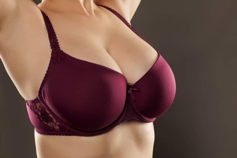 Large,And,Beautiful,Women,Breasts,In,Purple,Bra