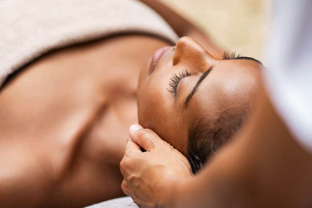 Beautiful,African,Woman,Getting,Face,Massage,In,Beauty,Spa.,Black
